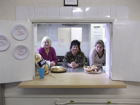 Pauline, Rose and Charlene at the kitchen hatch