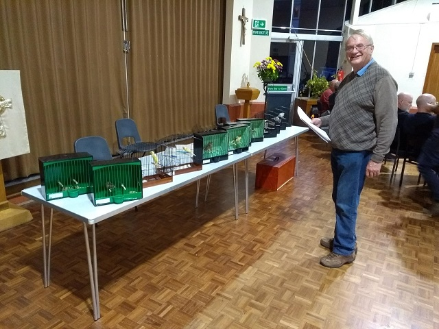 Richard in front of canaries and British birds at the September 2018 table show